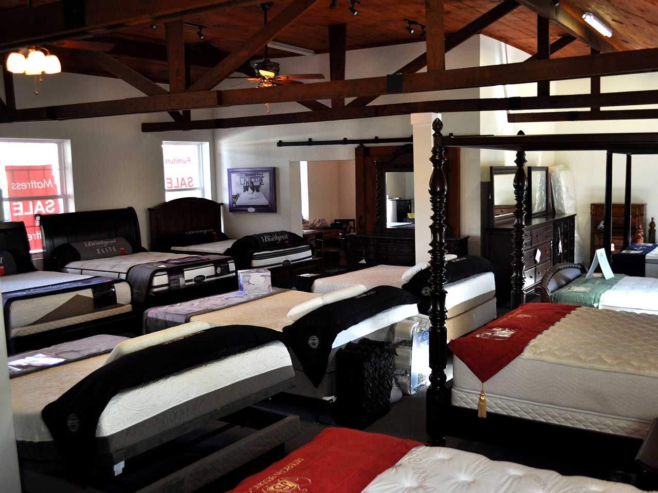 Photo of the beds and mattresses inventory inside SOS Mattress.